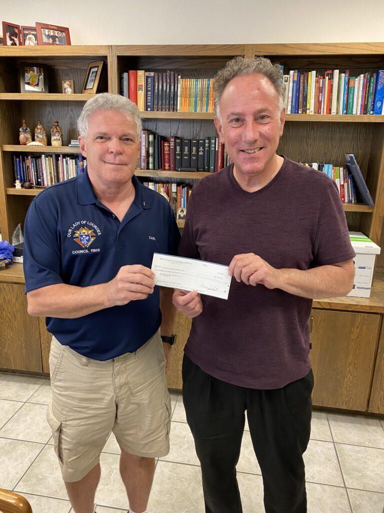 Fr. John Receives AZ State Raffle Check